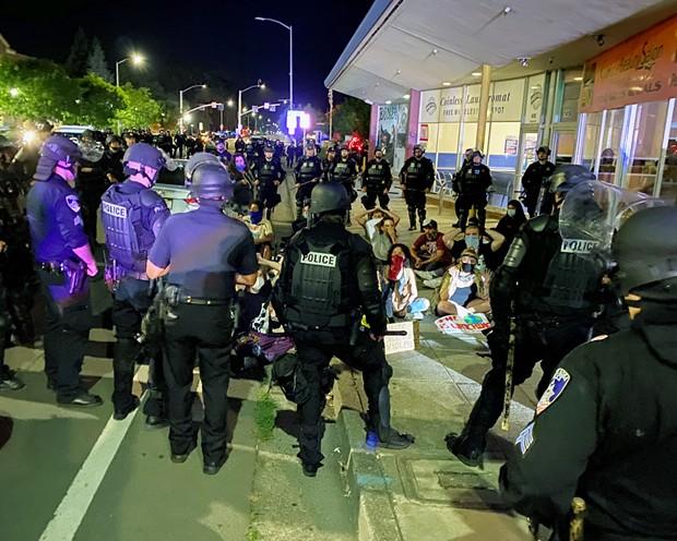 Police officers prepare to arrest protesters on Mendocino Avenue in Santa Rosa.