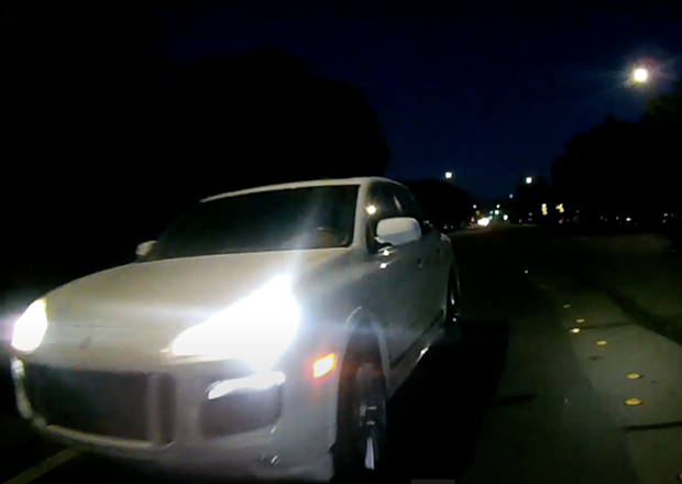 A screenshot from body-cam footage of the white Porsche SUV before it approached the crowd on Saturday night.
