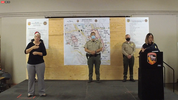Officials speak at a community briefing on Saturday, Aug. 22.
