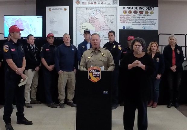 Sheriff Mark Essick discusses re-entry into the evacuation zone at a press conference.