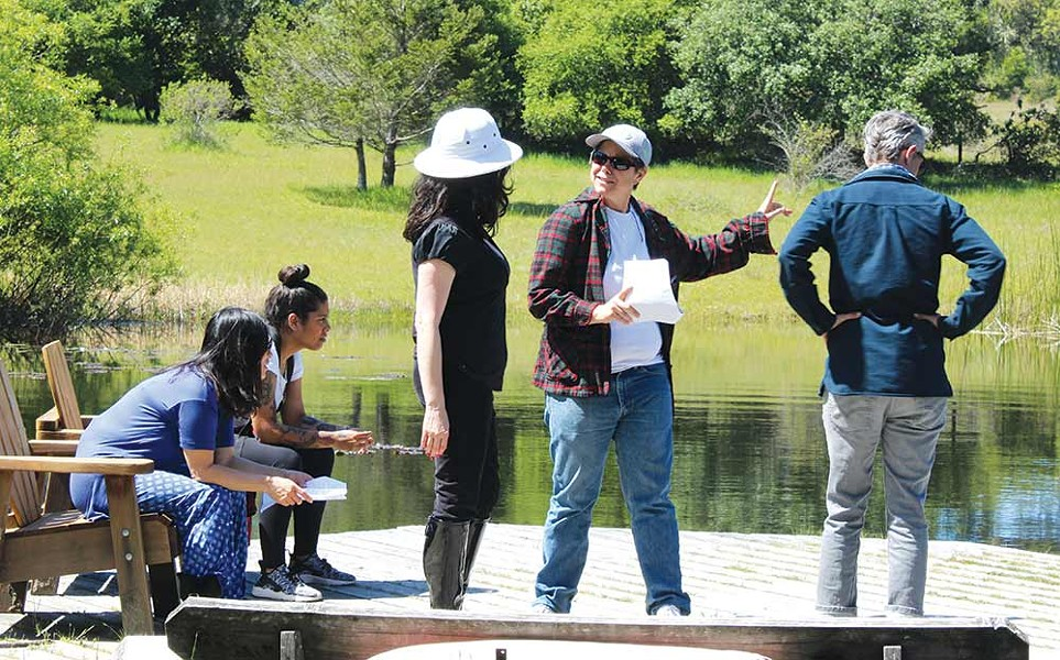 ON LOCATION Writer/director Angie Powers (second from right) talks with Guinevere Turner (middle) at the pond at OAEC during the filming of 'Lost in the Middle.' - PHOTO COURTESY ELIZABETH STARK