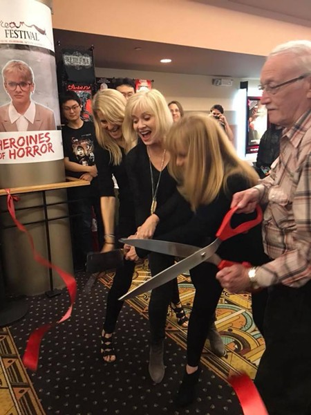 Writer/Director John Russo (right) and the Heroines of Horror chop the ribbon to open Silver Scream Fest.
