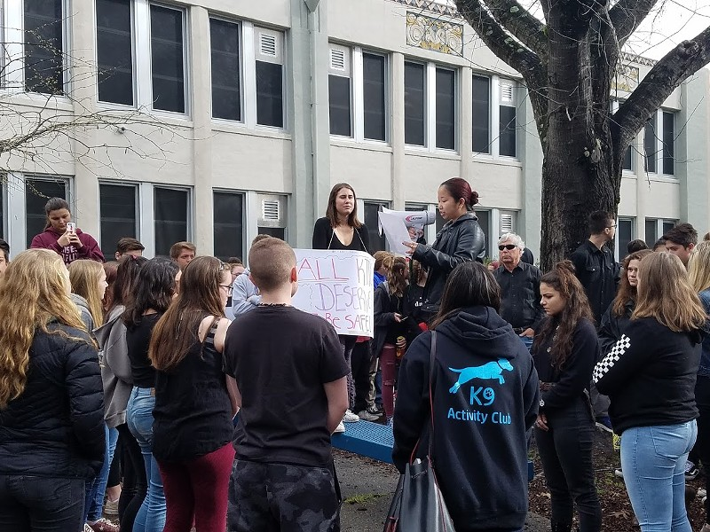 STUDENT LEADERS Junior Abbey Chinn, who helped organize the student walkout, addresses her fellow students Wednesday.