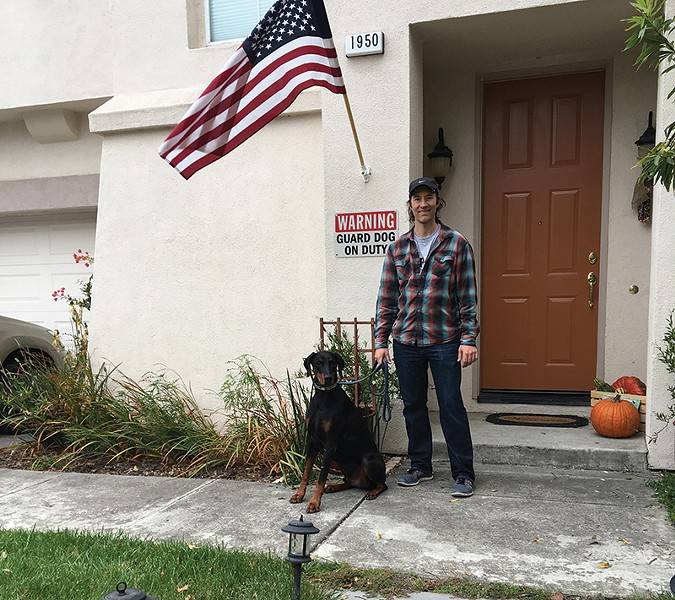 ON GUARD Earik Beanne and Oscar the dog stood their ground and saved their home from the 2017 fires.