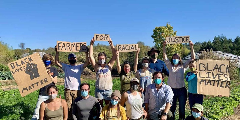 Members of Singing Frogs Farm in Sebastopol show their support for racial justice.