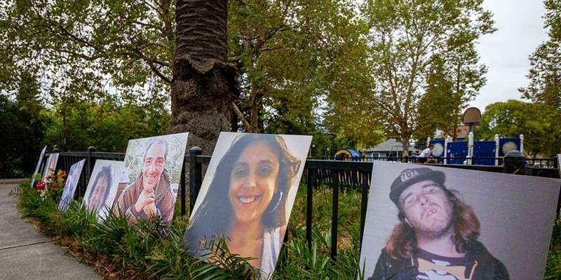 Organizers of an Oct. 22 event in Santa Rosa displayed images of people who died on Sonoma County's streets over the past eight years. Photo by Chelsea Kurnick