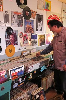 SPIN CYCLE Musician Kirk Heydt, proprietor of Petaluma's Spin Records, peruses the inventory.