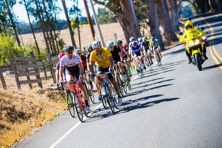 A pack of riders head up Highway 1. - ALEX CHIU