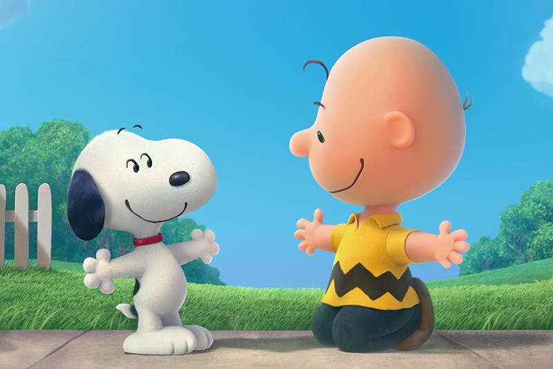 SNOOP HUG Charlie Brown embraces his fame in new Peanuts flick.