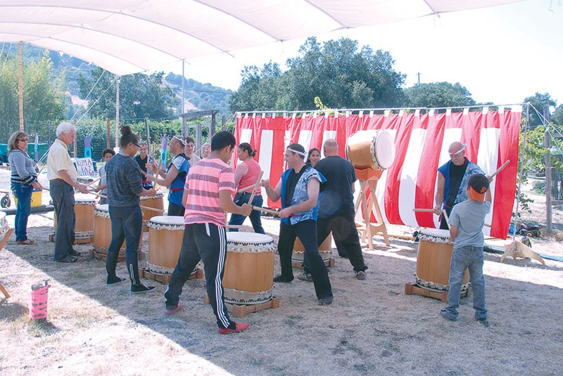 MAKE SOME NOISE  Taiko drummers bang out a beat at last year's Zen center bazaar.