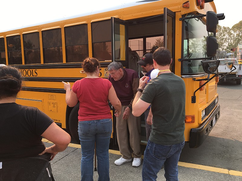 Evacuees from Oakmont arrive at Elsie Allen High School. - DAWN HEUMANN