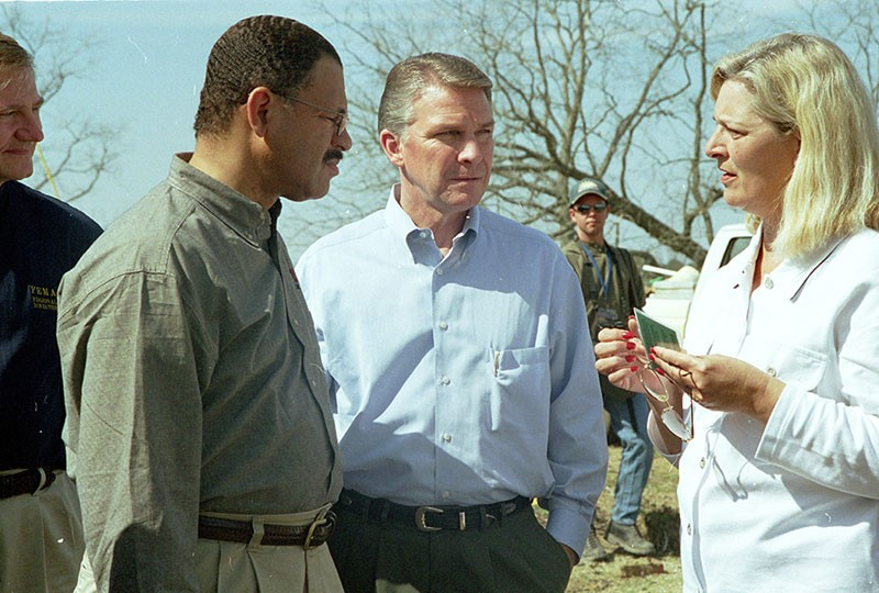 DISASTER ASSISTANCE  James Lee Witt, center, and Congressman Sanford Bishop speak - to a Georgia tornado victim in 2000 when he was FEMA director for Bill Clinton.