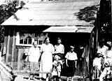 6bf67653_hurd_family_with_1st_cabin_1920s.jpg