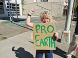 Pro-Earth Ben Wrightsman, a Live Oak Charter School sixth-grader and a member of his school's Climate Club, raises a sign (and awareness) about climate change at a weekly downtown Petaluma student protest.