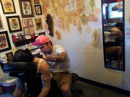 Wes is concentrating on my moms tattoo.