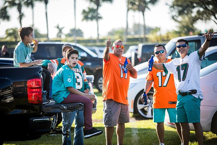 No one at a Dolphins tailgate is wearing an up-to-date jersey. - PHOTO BY IAN WITLEN