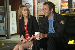 UNIVERSAL - A COP WHEN YOU NEED ONE: Kristen Wiig and Chris O'Dowd in Bridesmaids
