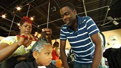 ROADSIDE ATTRACTIONS - A HAIR-RAISING EXPERIENCE: Chris Rock watches a stylist at work in Good Hair.