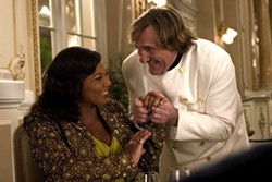 A MEAL FIT FOR A QUEEN Chef Didier (Gerard Depardieu) greets his favorite customer (Queen Latifah) in Last HolidayStephen Vaughan / Paramount