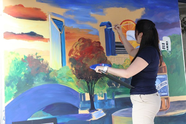 A painter creates the Charlotte skyline