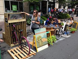 SHANNON BINNS - A parklet in Uptown, designed by Perkins + Will for PARKing Day, featured a bike rack.