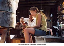 SIDNEY BALDWIN / FOX SEARCHLIGHT - A STICKY SITUATION: The close friendship between Lily (Dakota Fanning) and Zach (Tristan Wilds) raises eyebrows in a small Southern town in The Secret Life of Bees.
