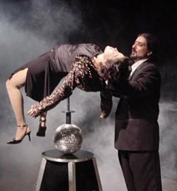 "JENNIFER REAM - Adyana de la Torre on the ""hypnotic balance"" and magic assistant John Floresta in Orange Lemon Egg Canary."