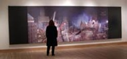 DAN SMITH - AFTERMATH: IMAGES FROM GROUND ZERO A - patron at the Hickory Museum of Art views the - carnage captured by photographer Joel Meyerowitz