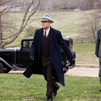 AGENTS IN HOT PURSUIT: J. Edgar Hoover (Leonardo DiCaprio) and Clyde Tolson (Armie Hammer) are on the move in J. Edgar.