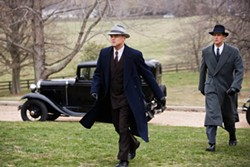 WARNER - AGENTS IN HOT PURSUIT: J. Edgar Hoover (Leonardo DiCaprio) and Clyde Tolson (Armie Hammer) are on the move in J. Edgar.