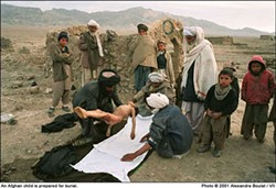 Alexandra Boulat's photo of an Afghan child being prepared for burial