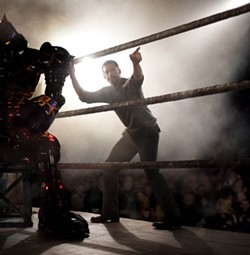 GREG WILLIAMS / DREAMWORKS - AND IN THIS CORNER: Charlie (Hugh Jackman) instructs his former league robot Noisy Boy in Real Steel.