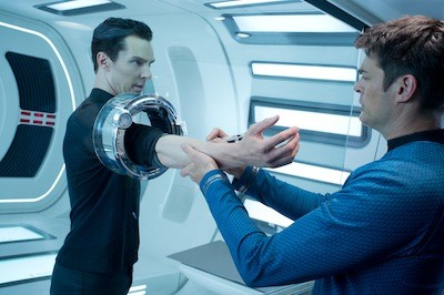 ARMED AND DANGEROUS: Dr. McCoy (Karl Urban, right) inspects John Harrison (Benedict Cumberbatch).