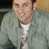 Arts Flash: Comedian John Heffron