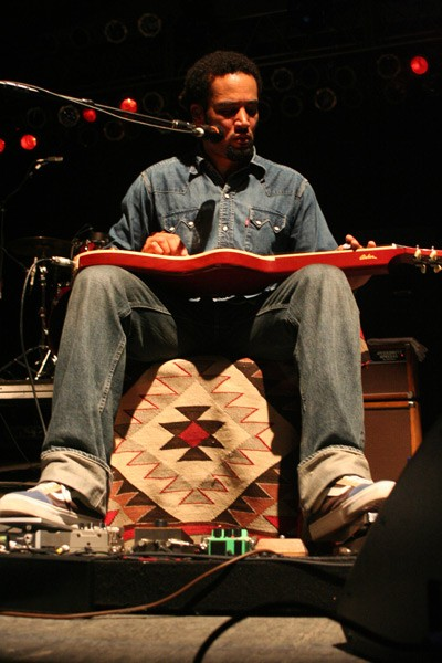 Ben Harper plays slide guitar during a jam with ?uestlove and John Paul Jones. (Bonnaroo, Manchester, Tenn., June 14-17)