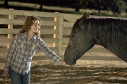 MERRICK MORTON / FOX - BLACK BEAUTY Katy (Alison Lohman) extends a helping hand to the wild mustang she encounters in Flicka