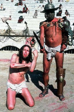 WARNER - BLASPHEMOUS? HEY, TAKE THAT! Scene from - Monty Python's Life of Brian