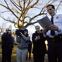 Capt. Estes of the CMPD reads the new city ordinance to members of Occupy Charlotte