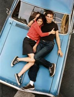 BEN GLASS / TOUCHSTONE - CAR TALK Amanda Peet and Ashton Kutcher bond on the - hood in A Lot Like Love