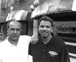 RADOK - CARLO'S ITALIAN GRILL owned and operated by Joe, - left, and Frank Brucia and their brother Giacoma (not - pictured) is now open downtown