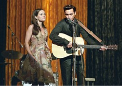 SUZANNE TENNER / FOX - C+C MUSIC FACTORY Carter (Reese Witherspoon) and Cash (Joaquin Phoenix) burn up the stage in Walk the Line.