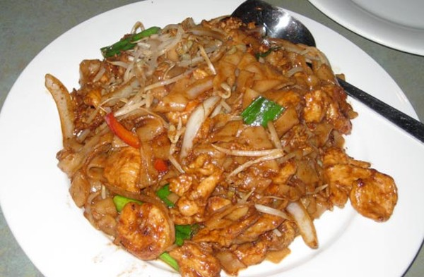 Char Kway Teow - Malaysian pan-fried flat noodles with shrimp and chicken.