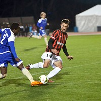 Charles Eloundou works past a Charleston Battery defender during the debut game of the Charlotte Independence on March 27.