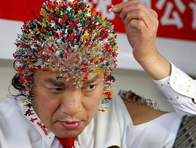 chinese-man-needles-olympic.jpg