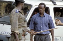 FRANK CONNOR / UNITED ARTISTS - CLUB DREAD Paul Rusesabagina (Don Cheadle) - fears for the safety of his family in - Hotel Rwanda