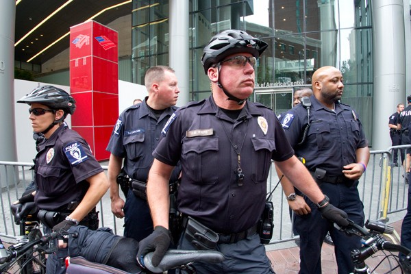 CMPD Officers standing guard in front of the Bank Of America shareholders meeting entrance. (Photo by Grant Baldwin)