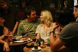 VICTOR BELLO/THE WEINSTEIN COMPANY - COCKY SPANIARD: Suave Juan Antonio (Javier Bardem) introduces Cristina (Scarlett Johansson) to Spain's many pleasures in Vicky Cristina Barcelona.