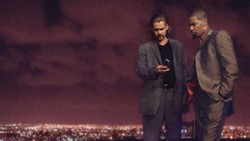 UNIVERSAL PICTURES - COOL AS VICE Crockett (Colin Farrell) and Tubbs (Jamie Foxx) get down to business in Miami Vice