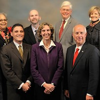 County Commissioners grin and bear it: Cogdell (front row, second from left), Roberts (center).