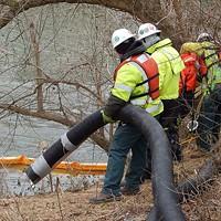 Crews vacuuming coal ash from the Dan River